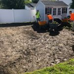 men landscaping a backyard